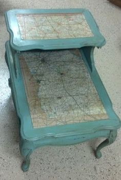 Brown chalk paint base coat, Red chalk paint in random spots. Main color is Behr Gulf Winds mixed with Websters Chalk Paint Powder. Sanded to distress. After map is affixed, aged and sealed, whole table is finished with Fiddes and Sons Light Wax, and finally Fiddes and Sons Rugger Brown Wax to give aged appearance.