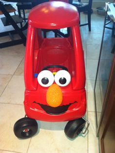 Elmo Car! Little Tikes Cozy Coupe car spray painted red, styrofoam eyes and nose, mouth drawn on with sharpie!