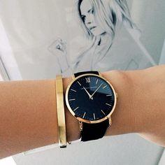 black + gold big faced watch.