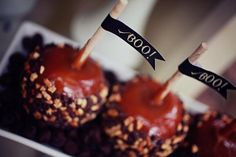 Caramel Apples are a must-have at a Halloween Party. Love the set-up!