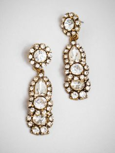 If you like your glamour with a vintage kick, then you'll fall for these gorgeous drop earrings. Subtly inspired by deco graphics and crafted from a treasure chest's worth of ice-white gems, they're simply spectacular. Style Me Pretty + BaubleBar