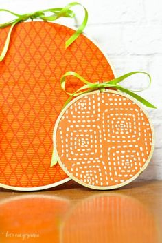 Orange fabric, green ribbons, and fabric hoops can be transformed into pumpkins for fall and Halloween decor!