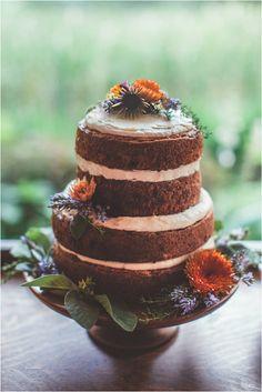naked wedding cake with wildflowers, photo by Hazelwood Photo http://ruffledblog.com/two-artists-marry-atop-columbia-gorge #weddingcake #cakes