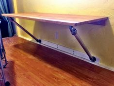 Wall Mounted Desk that uses Kee Lite aluminum fittings to support the desktop.