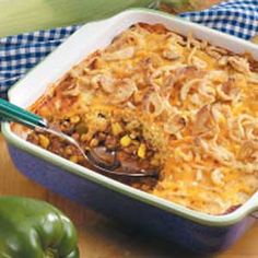 Corn Bread Taco Bake Recipe - The corn bread and beef bake together in the same casserole dish, making this entree convenient. It's packed with tempting seasonings, and the cheese and onions make an attractive topping. This recipe is: Contest Winning