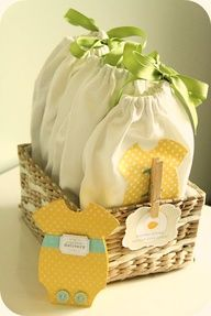 Basket of Baby To-Go Pouches Tutorial ~ Help a new mother feel not-so-overwhelmed with this useful and beautiful baby shower gift.  Each pouch contains different items which correspond to their contents which include those on-the-go essentials like diapers, wipes, a new onesie, pouches of formula and baby food, etc.
