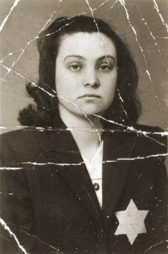 Portrait of Klara (Maislis) Swimmer wearing a yellow star. Hungary, 1944.