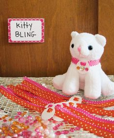 """Stuffed Cat """"Adoption Station"""" as Party favors. Kids can decorate their collars."""