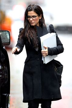 Sandy Bullock looking smart and stylish in glasses