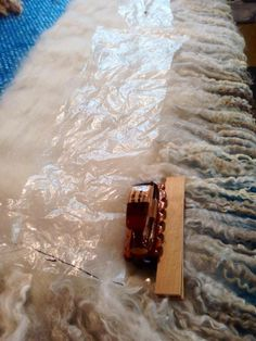Felting with resists and wool locks and the EDGE Palm Washboard felting tool