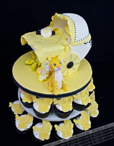 Baby carriage cupcakes and cake by Design Cakes, via Flickr