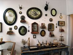 Love the collective arrangement of these old frames & finds.