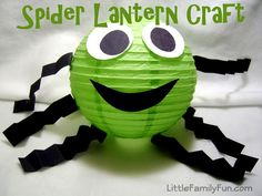 Spider lantern craft!  Using construction paper & double stick tape with a grass green paper lantern or any color of your choice to create this fun party decoration. Shop 50+ colors online at http://www.partylights.com/Lanterns/Lanterns-by-Color.