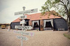 LOVE these kind of signs!  Magical Vintage Carousel DIY Barn Wedding - Bridal Musings Wedding Blog