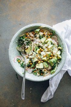 cauliflower + roasted garbanzo rice + peas with avocado apples + herbs