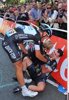 Mark Cavendish rests against a barrier after his crash Photo credit © Tim de Waele