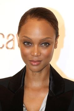 Tyra Banks pairs fishnet mask with updo!
