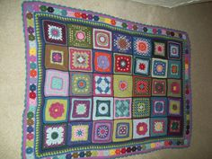 A beautiful collection of granny squares; especially like the borders  #DIY #craft #crochet #granny_squares