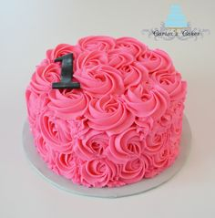 pink 1st birthday smash cake....looks like one of the baby shower cakes. ?????