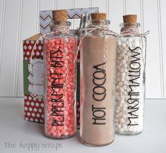 I used my Cricut to cut out the vinyl for the bottles. After filling the bottles up with cocoa powder, mini marshmallows, and mini peppermint marshmallow bits, I put the corks in, and I wrapped the tops with twine then tied a bow.