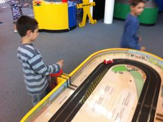Hand-powered scalextric at @techniquest in Cardiff! The dynamo uses the kinetic energy from the handle to generate electrical energy by electromagnetic induction.