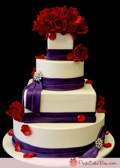 I think purple and red are so pretty together. They look celebrative, rich, pretty, everything you want cake to show. IMO Of course I love all these cakes-it's one of my many weaknesses