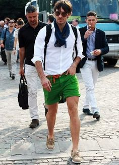 Great casual look.  Love the scarf with white oxford shirt, green rolled up shorts and the neutral shoes