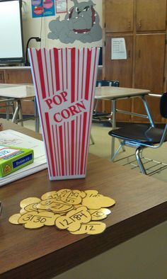 """My newest creation: Popcorn multiplication and division. Facts are on yellow laminated construction paper and they go in the handy dandy 1$ popcorn container from Target. Mixed in are pieces that say """"pop"""". Once they draw a pop card all of their collected pieces go back in the container. The player with the most popcorn wins"""