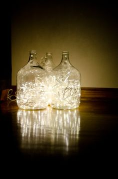 "Don't forget this old trick for adding a POP of light to your consignment shop window displays, says TGtbT.com A little ""extra"" light in your display is always an eye-catcher... Recycled water cooler jug!"