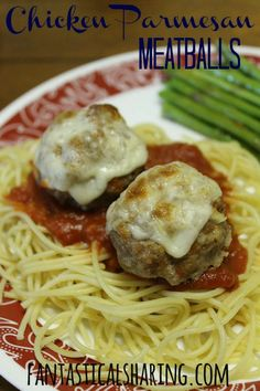 Chicken Parmesan Meatballs | Delicious seasoned meatballs topped with cheese all on a mountain of spaghetti