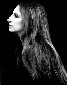 "Previously unpublished, this side view of Barbra Streisand is iconic. This photo, taken in 1969, is by Steve Schapiro. Along with other iconic photos of his career, this one is featured in his new book, ""Steve Schapiro: Then and Now."""
