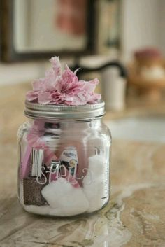 Glass etching material or stickers or something, mason jar, ribbon, fabric, cotton balls, nail file and clippers, nail polish remover, nail polish, lotion, and maybe some type of candy.