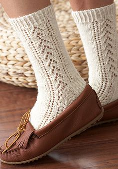 At home or on the go, give your feet some homemade flair in these beautiful lace-and-cabled socks. Seaming video tutorial link in PDF. Shown in Patons Kroy Socks.