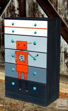 cute-ify a boy dresser.....and add a robot!  love the orange.