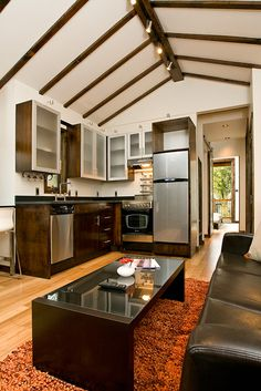 All the kitchen comforts in a small space...love the high ceilings too.