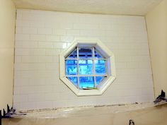 Sarah of The Ugly Duckling House used some leftover tile from her kitchen backsplash to tile a wall in her laundry room. It looks smashing! Still to come: trim work and a shelf. We can't wait to see how it turns out! || @uglyducklingdiy