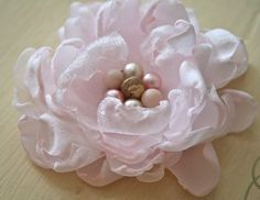 Beautifully handmade.  She gives you step-by-step directions for making this. flower making, lapel pins, bridal bouquets, polka dots, hair clips, fabric flowers, closet, flower tutorial, handmade flowers