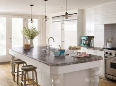 The countertops for this stunning kitchen feature our Wilsonart® HD® High Definition® Laminate in Winter Carnival, complete with a Wilsonart® Crescent Decorative Edge and HD510 Double Equal HD Integrated Sink.