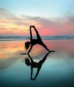 Yogini reflecting in the sand.