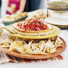 Maximize table space by using tiered appetizer platters. More entertaining ideas: http://www.bhg.com/party/birthday/themes/how-to-organize-outdoor-party-food-and-drinks/?socsrc=bhgpin060112#page=1