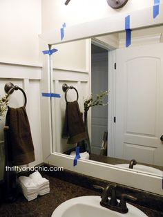Thrifty and Chic: DIY --- how to add moulding to a boring bathroom builder.  From boring to beautiful~