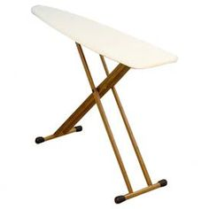 """Showcasing a natural bamboo base and classic fibertech top, this stylish ironing board lends a touch of organic appeal to your laundry room.     Product: Ironing boardConstruction Material: Bamboo and cottonColor: NaturalFeatures:  Thick fiber pad provides matte-free resilient ironing surfaceFolds for storageDimensions: 35.5"""" H x 54"""" W x 14"""" D"""