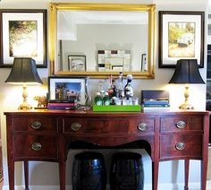 buffet bar with mirror, framed art/picture and lighting