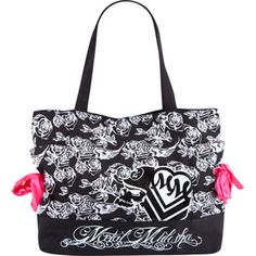 """Metal Mulisha Bowlicious canvas tote bag. Allover Metal Mulisha logo rose print. Small slip pockets on sides with large contrast bow accents. Magnetic snap close main compartment features interior zip pockets and organizer pockets. Approx dimensions: 12"""" x 16.5"""" x 4""""(31cm x 42cm x 10cm). Imported.$37.99"""