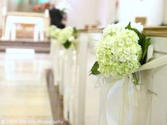 Creative Ideas for Church Wedding Flowers Using Decorative Pew End Markers