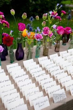 Same LOVE here! The escort cards set up in front of a bunch of colored vintage bottles. Love the look ;) Photography by christianothstudio.com, Event Planning by daughterofdesign.com, Floral & Event Design by hatchcreativestudio.com