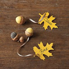 Use Playful Place Cards | Write the name of each guest on a leaf place card attached to a little felted acorn that doubles as a fun party favor. Scatter loose felted acorns—or real ones—up and down the table to play up the natural theme.
