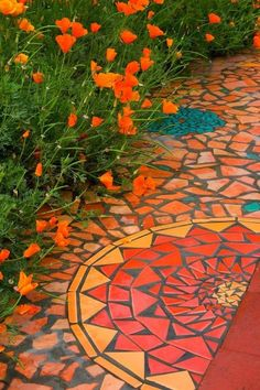 mosaic pathway, garden pathways, garden mosaics, garden paths, orange flowers, mosaic tiles, mosaic outdoor, bright colors, backyard orange