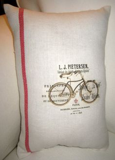 French Country Vintage Grain Sack Bicycle Pillow, Paris Inspired Red French Ticking Stripe Cushion, Shabby Chic Home Decor. $14.79, via Etsy.