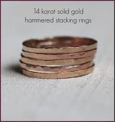 Solid 14k gold hammered stacking rings. Choose from pink, yellow and white gold. From Praxis Jewelry